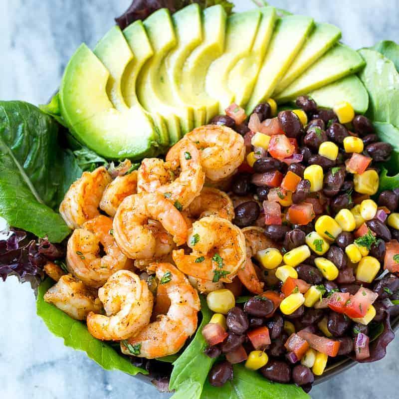salad bowl with shrimps salsa and avocado