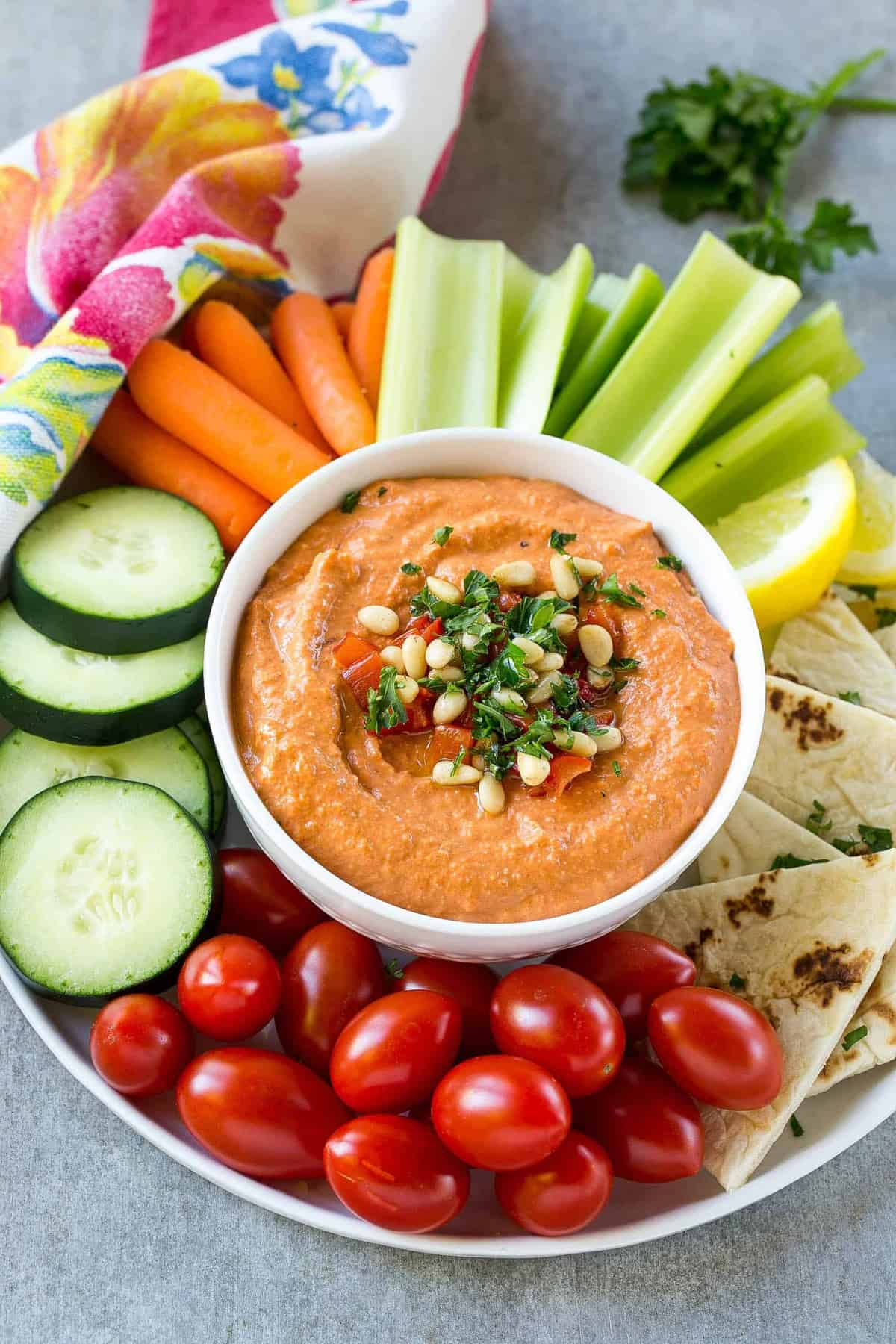 veggies on a platter with red pepper hummus