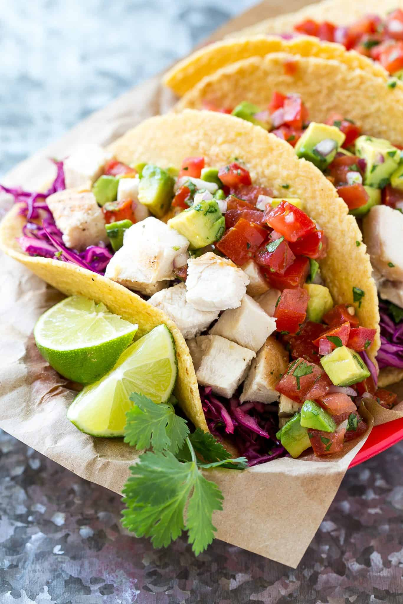 chicken tacos with lime wedges