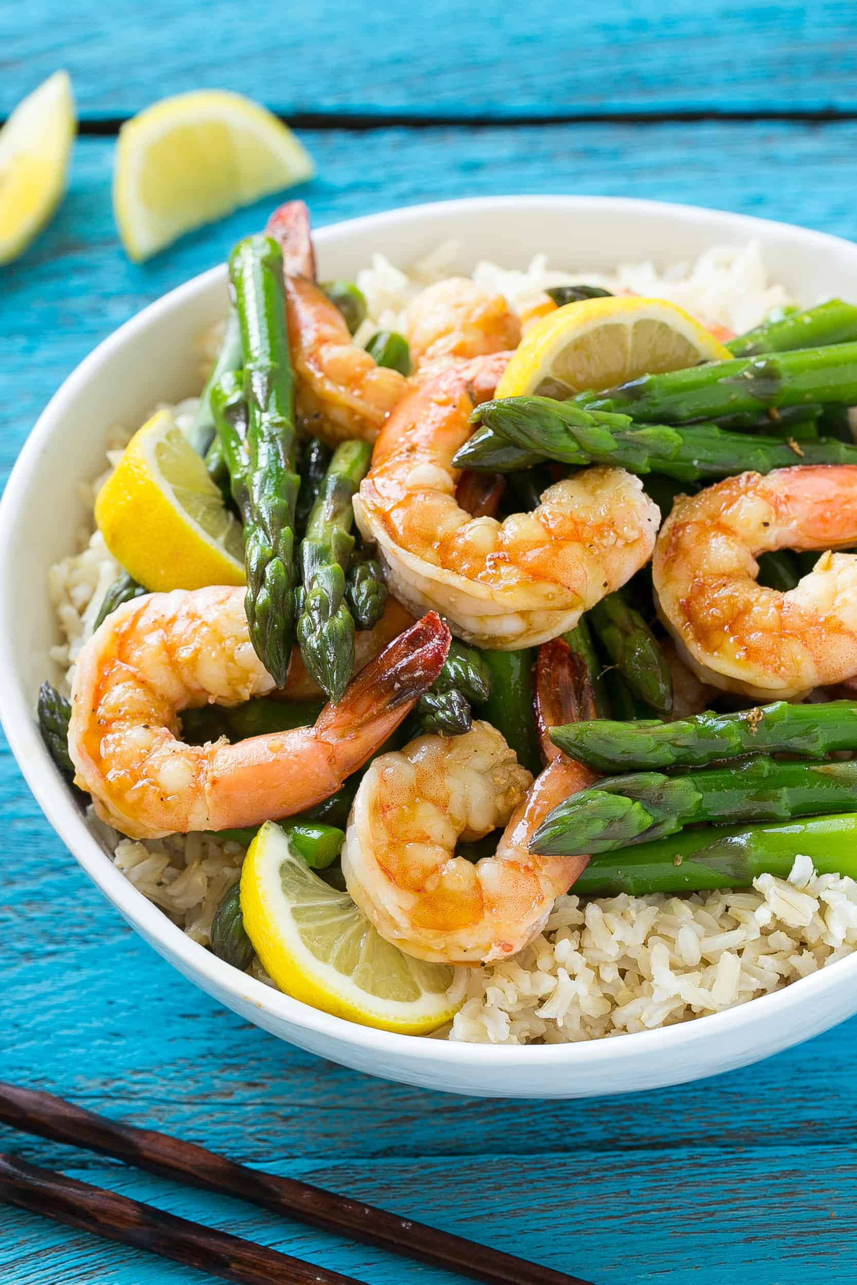 lemon ginger shrimp and asparagus in a bowl with rice