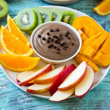 chocolate fruit dip surrounded by fruit