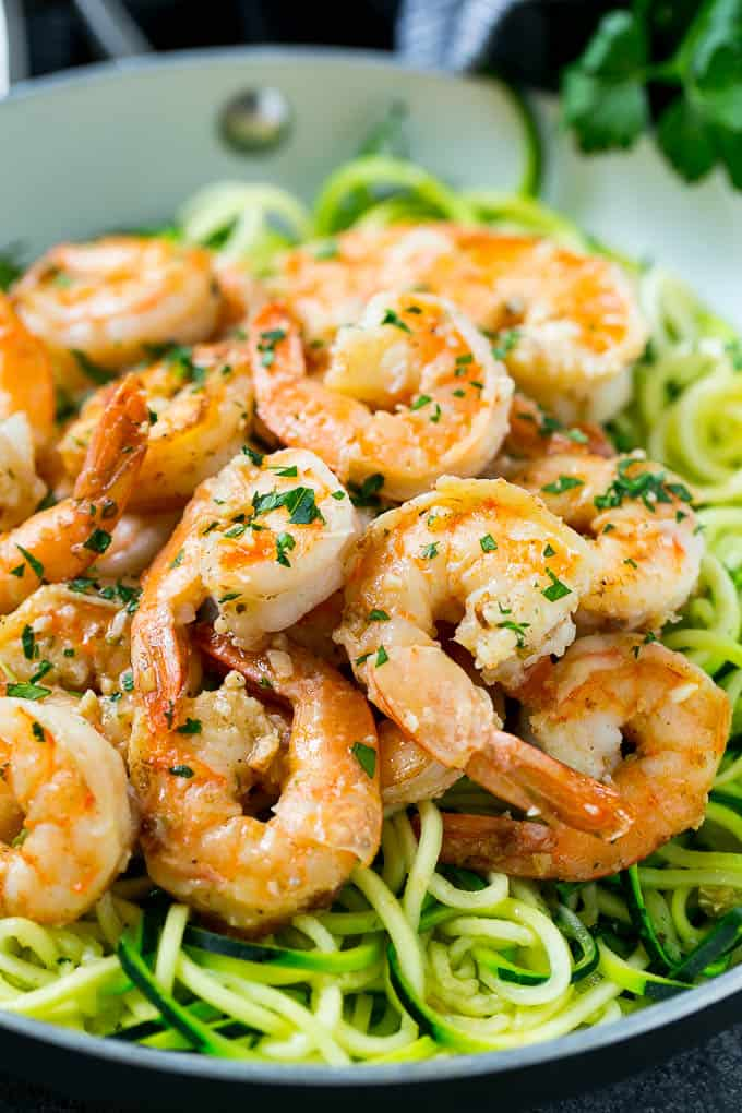 close up of shrimp on zucchini noodles.