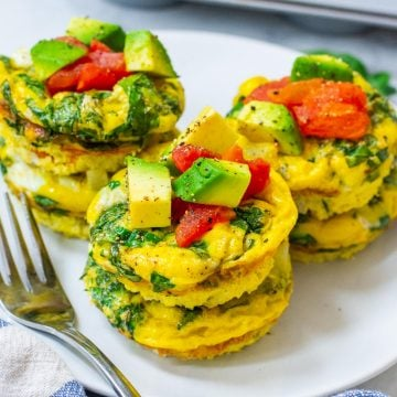 egg muffins stacked up on a white plate