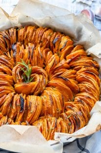 sweet potatoes dish on parchment paper in dish