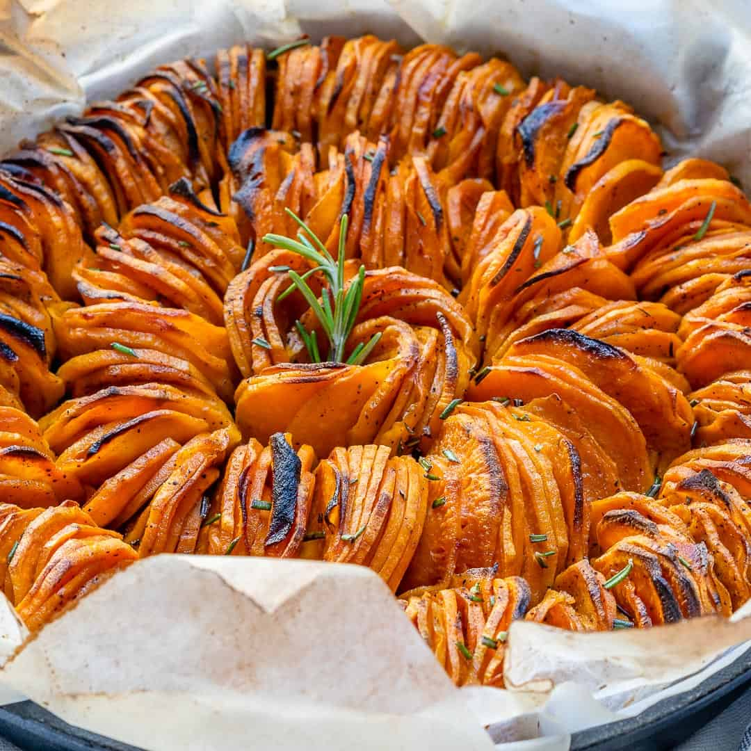 sweet potato dish with rosemary garnish