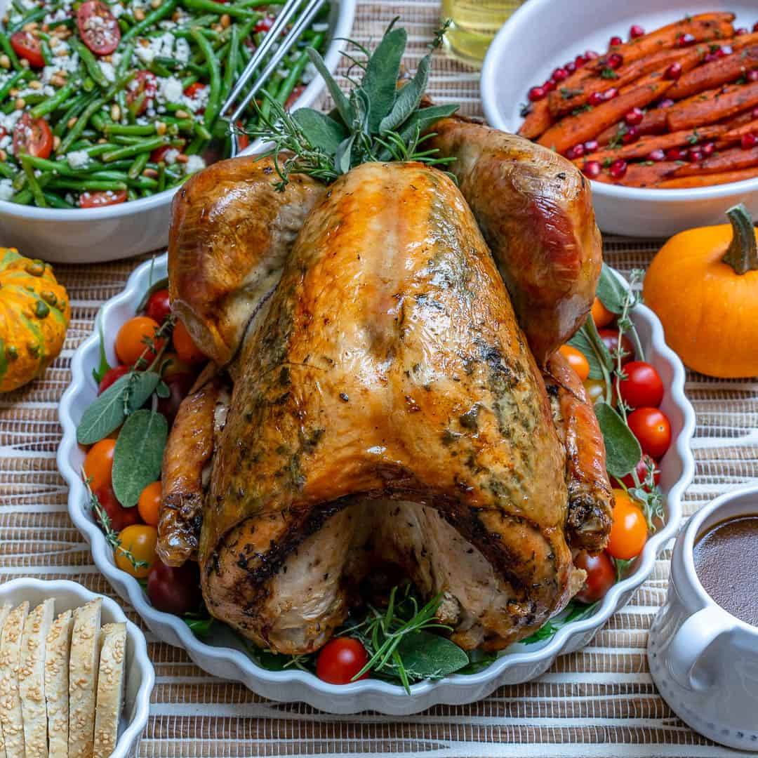 easy thanksgiving turkey recipe on a table with sides
