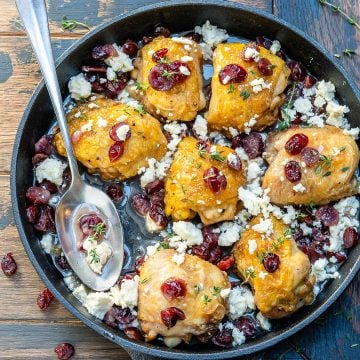 baked chicken thighs topped with cranberries