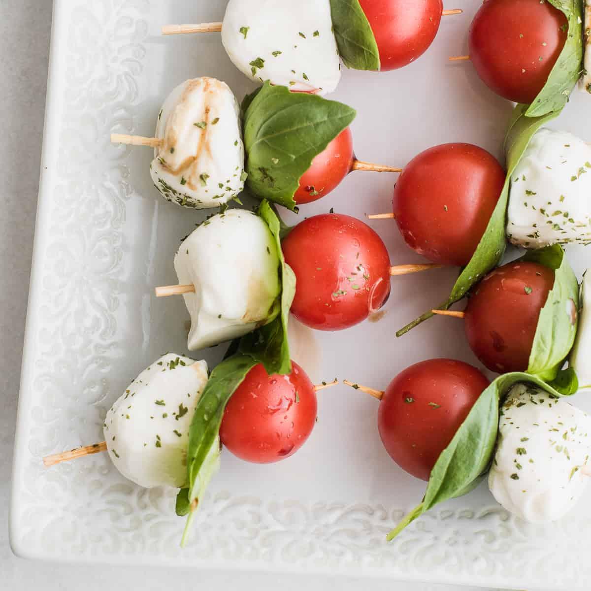 cherry tomato, basil leaf and mozzarella balls on a skewer