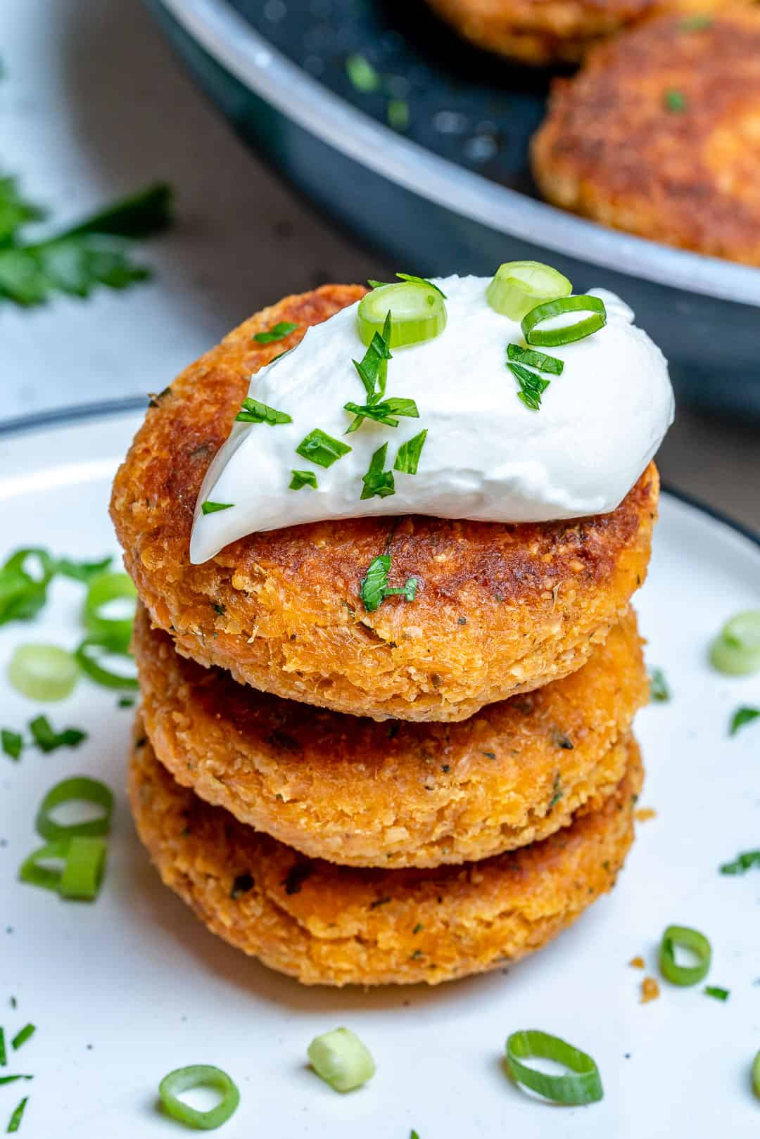salmon cakes stacked on each other