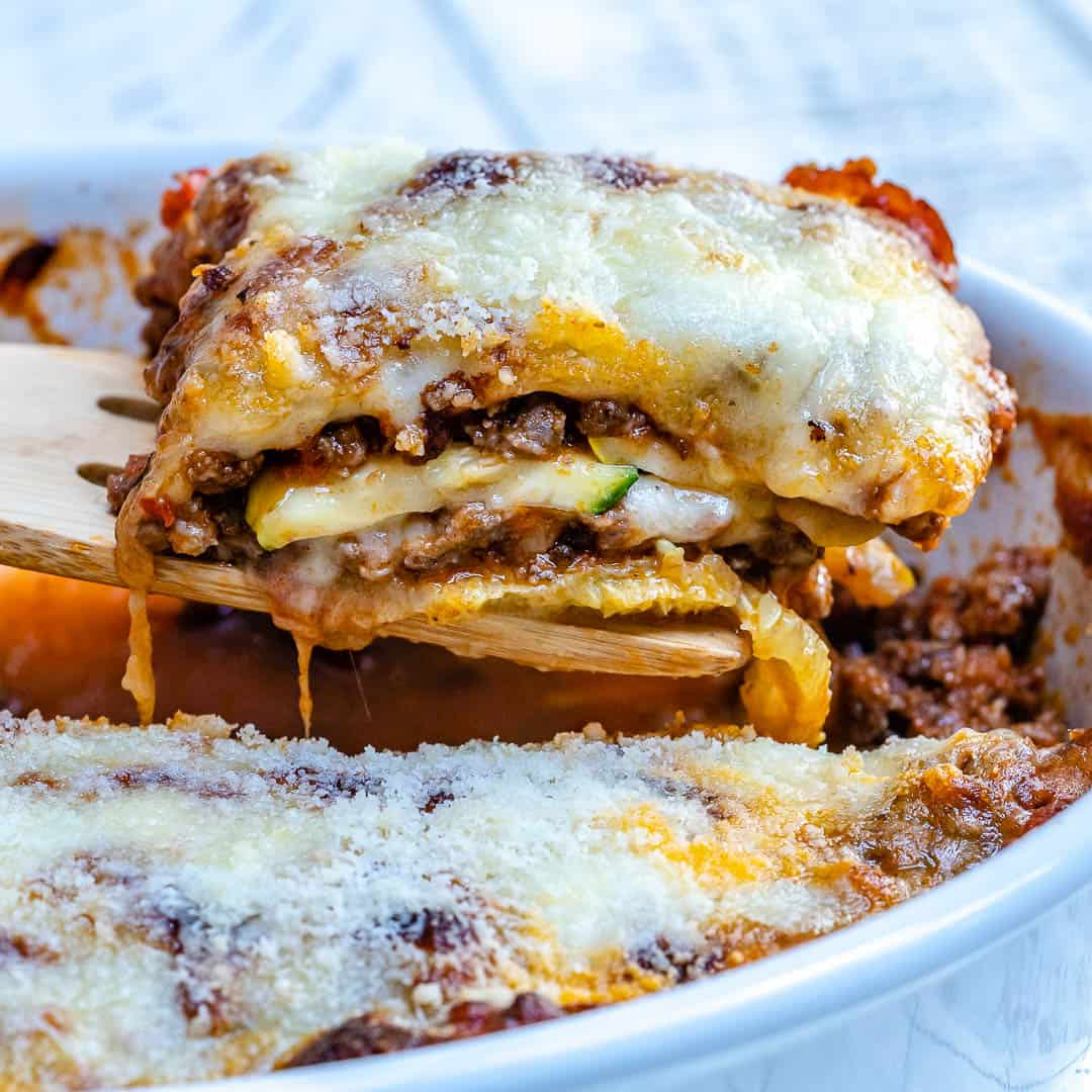 low carb lasagna pasta slice on a wooden spoon