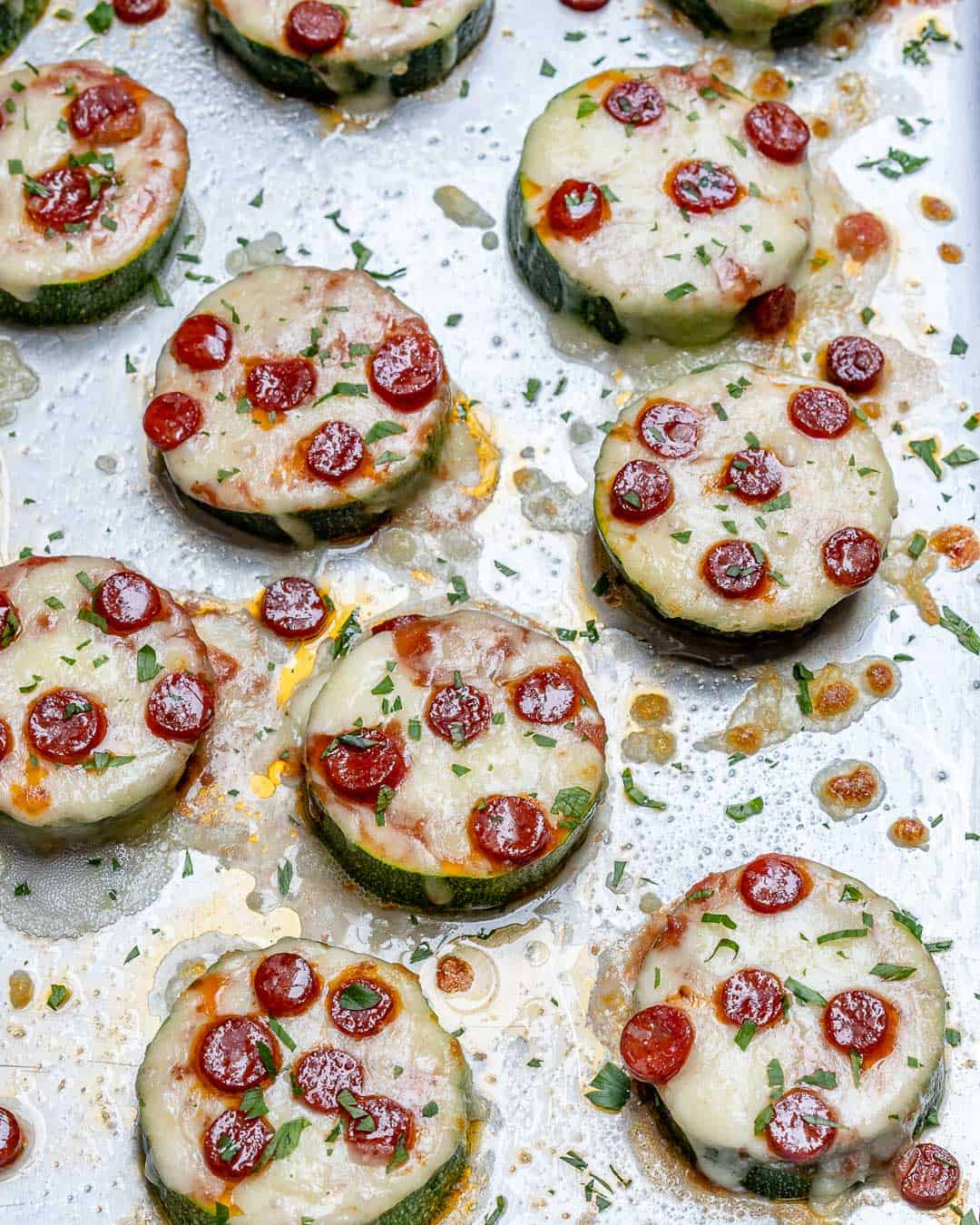 overhead shot of zucchini pizza bites on a tray