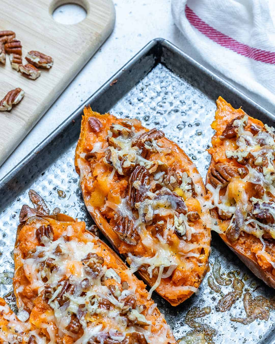 sweet potatoes baked and then topped with pecans and cheese