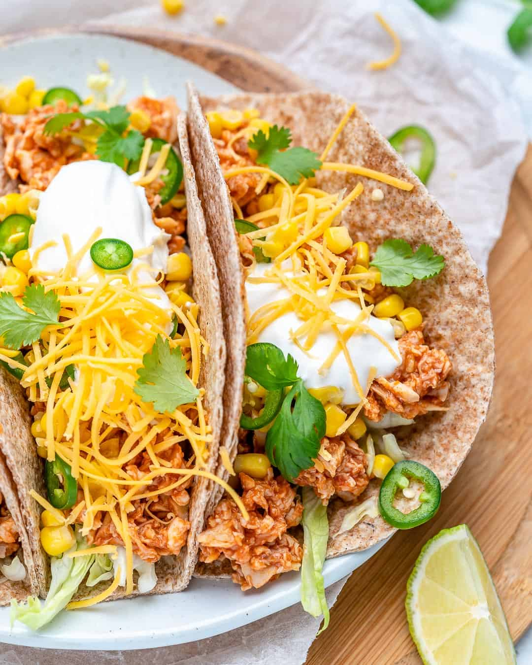 buffalo chicken tacos on plate with lime