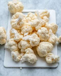 cut up cauliflower on cutting board