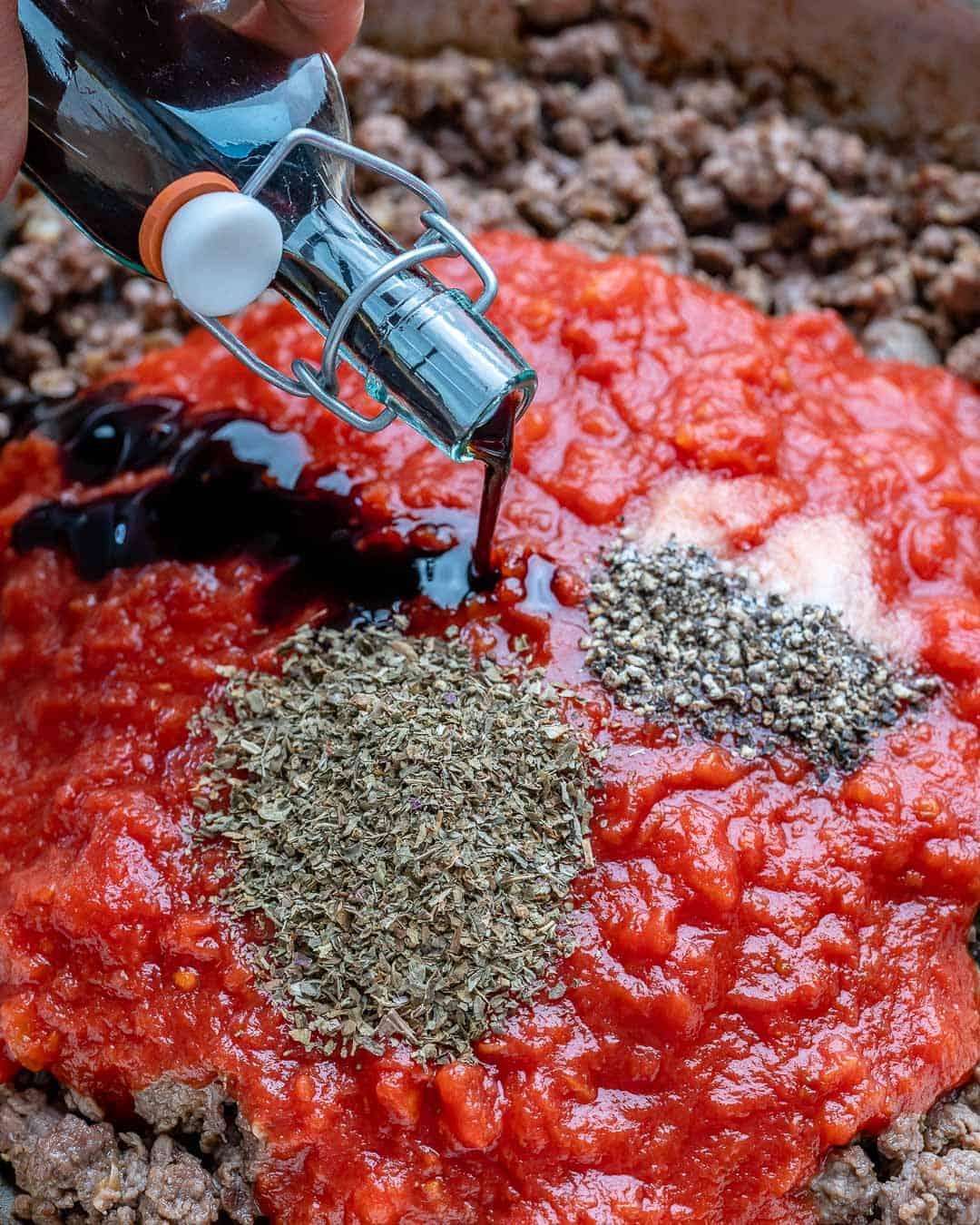 Add the tomatoes, balsamic vinegar, dried basil, salt, and pepper.