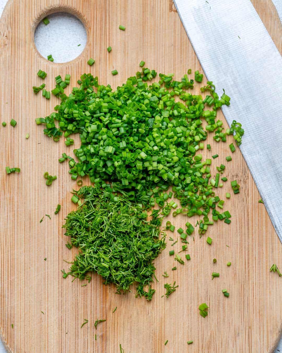 Chop fresh herbs using a sharp knife.