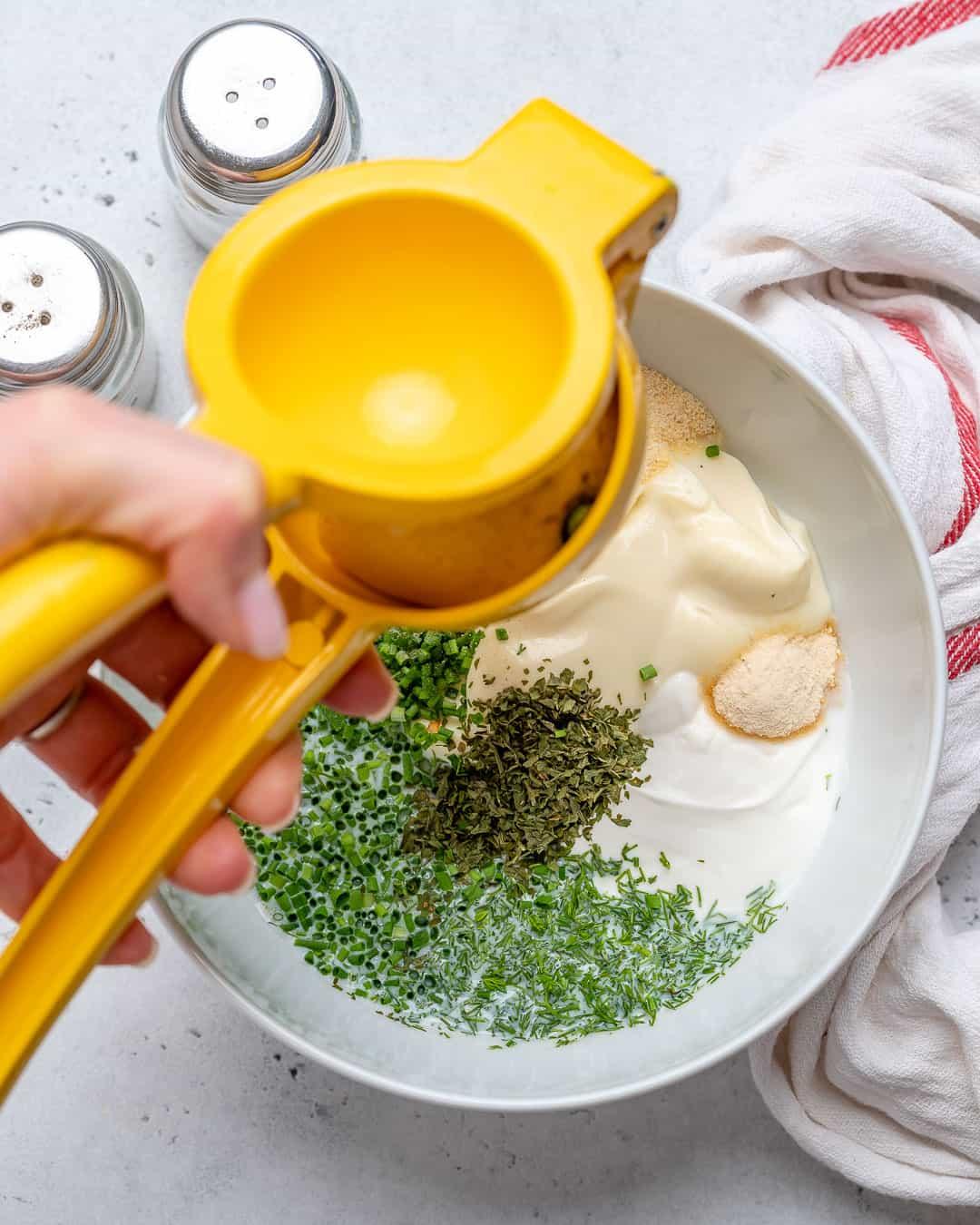 Add lemon juice to bowl.