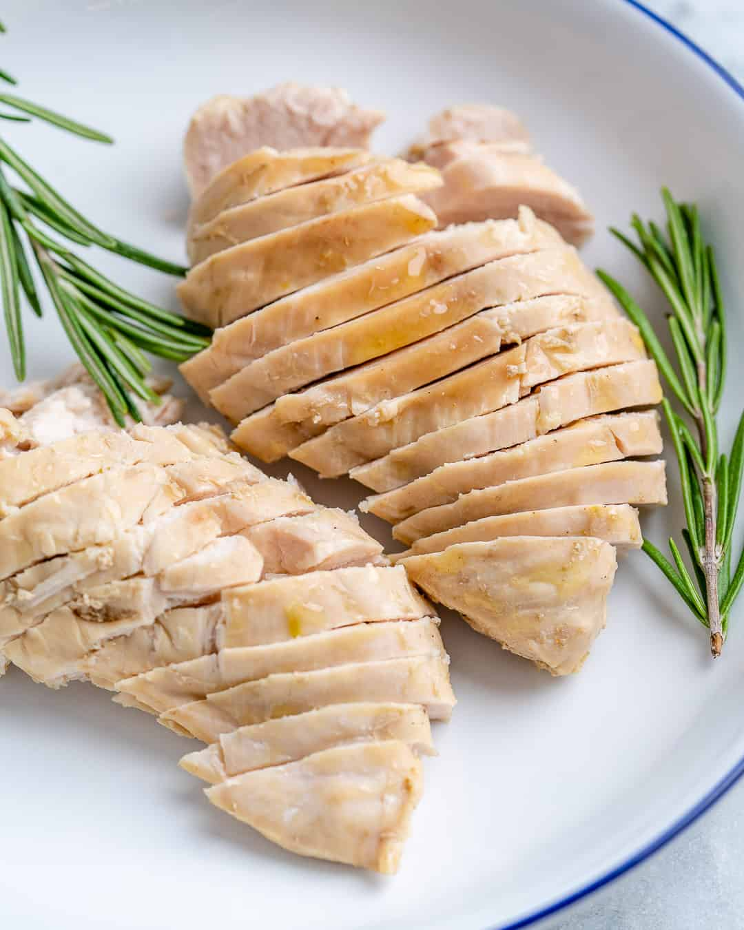 Sliced poached chicken on plate