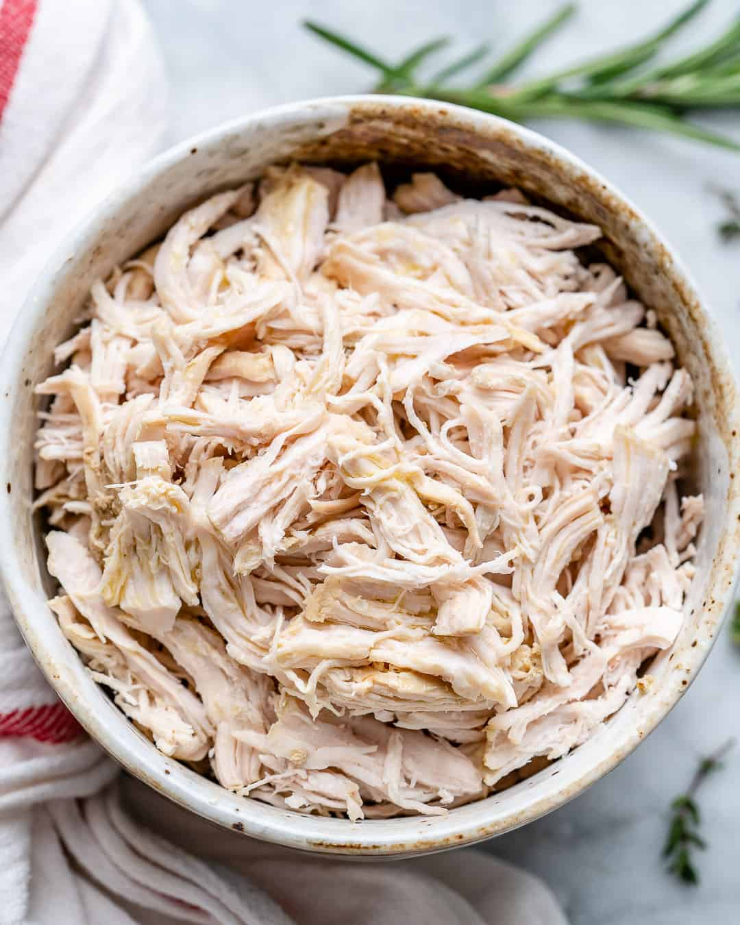 Poached chicken shredded in bowl