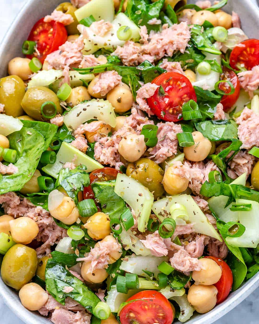 healthy chickpea and tuna salad recipe with tomatoes, celery, and olived