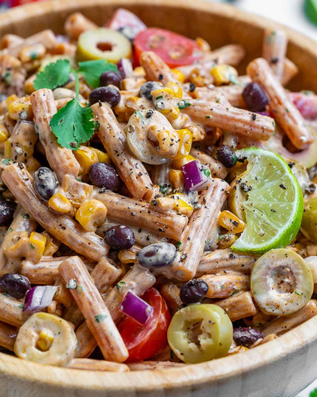 close up view of southwest pasta salad in a bowl