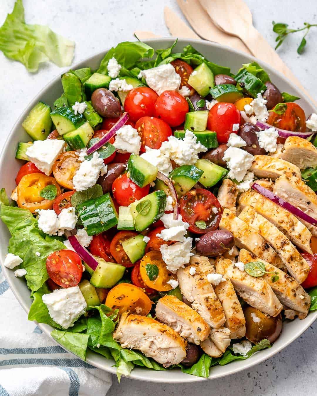top view salad made greek style with chicken and feta cheese