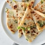 top view of cut up scallion pancake on a plate