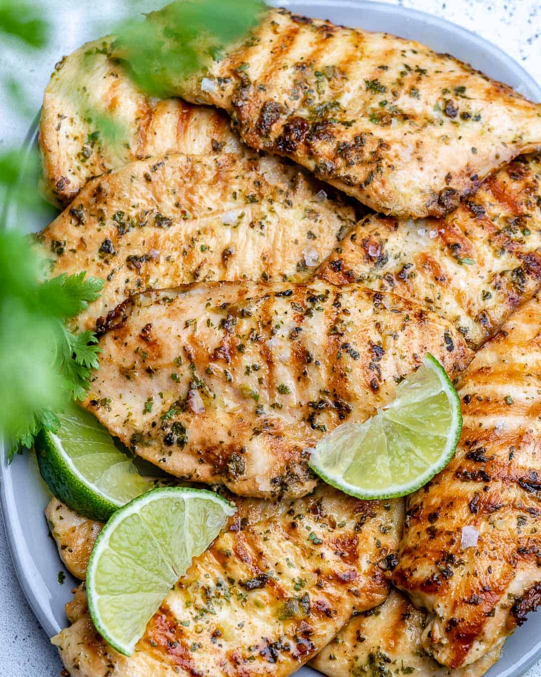 grilled chicken breasts on platter