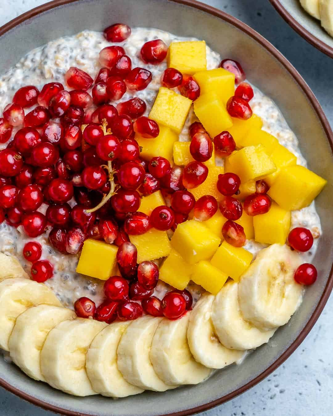oatmeal with fruit garnishes in bowl