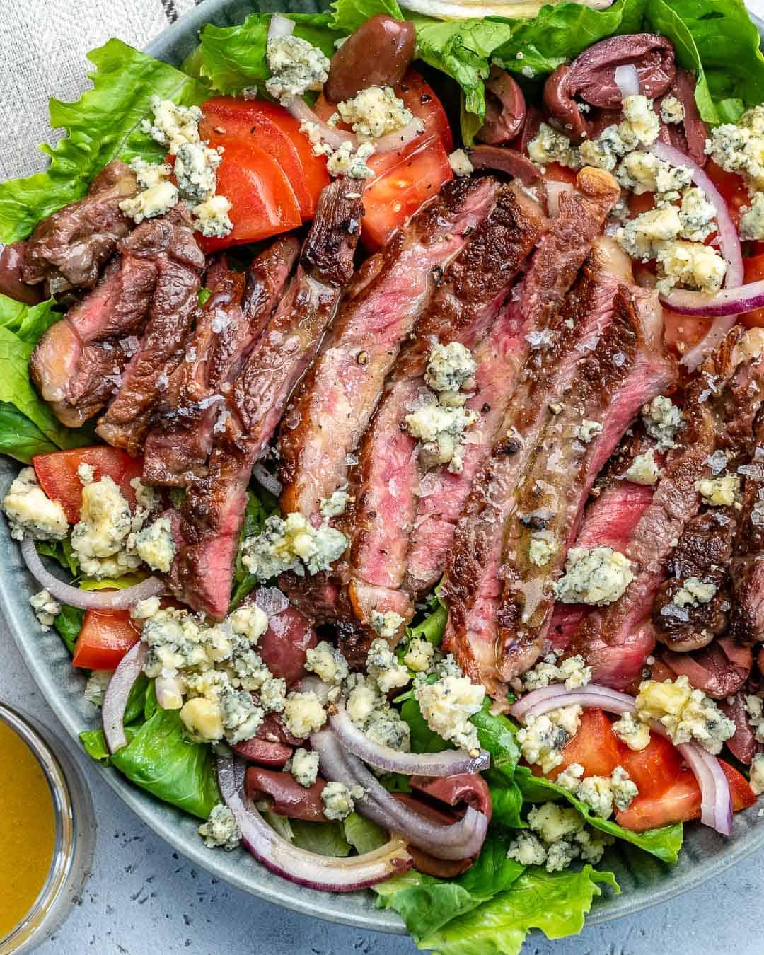 sliced steak on salad base