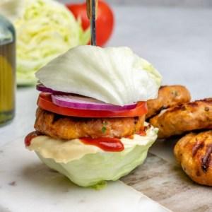 side view of no bun chicken burger on a platter