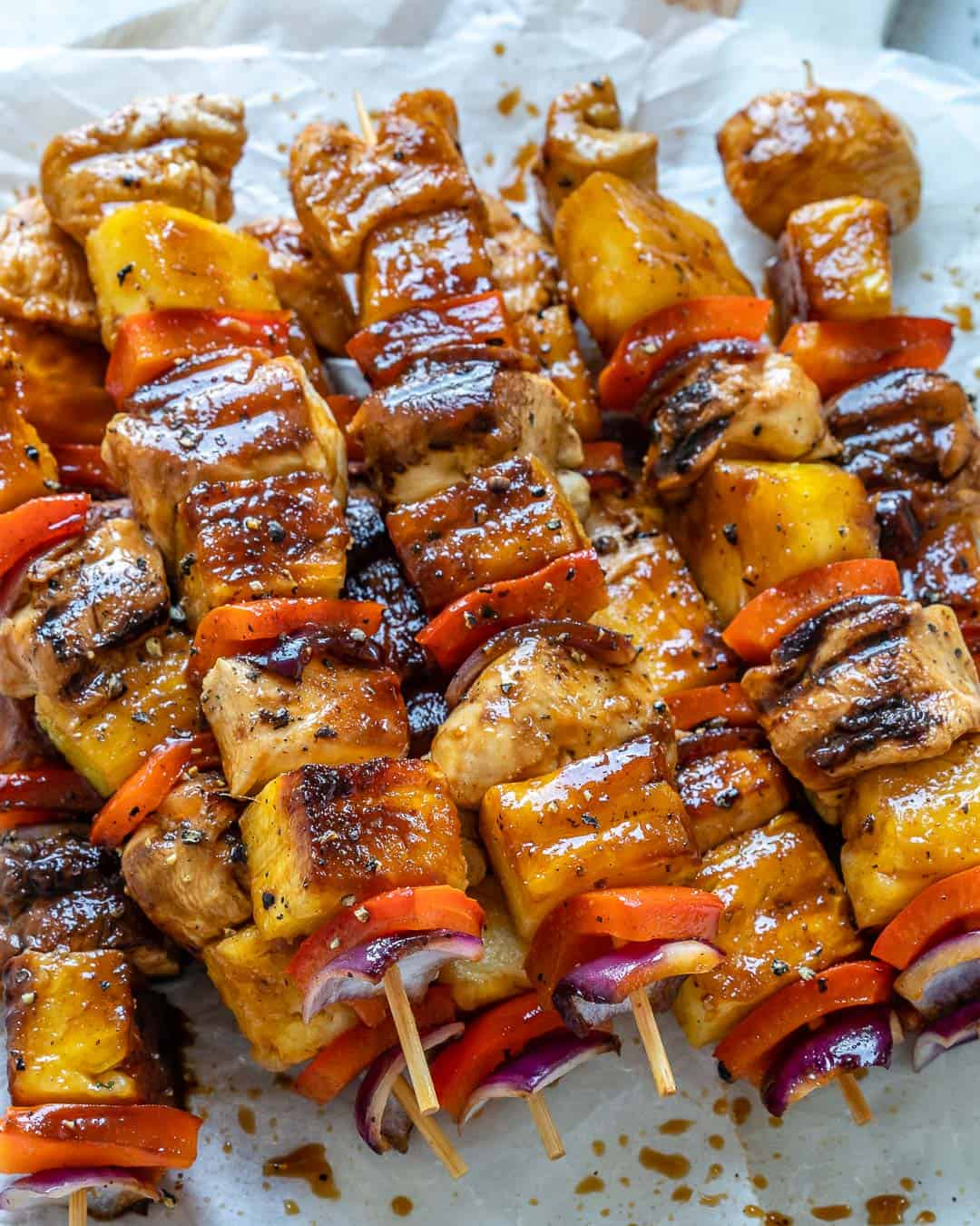 grilled chicken skewers on a parchment paper