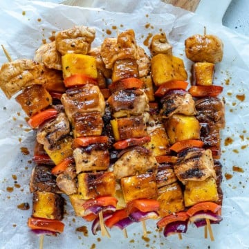 top view of chicken kabobs on a parchment paper