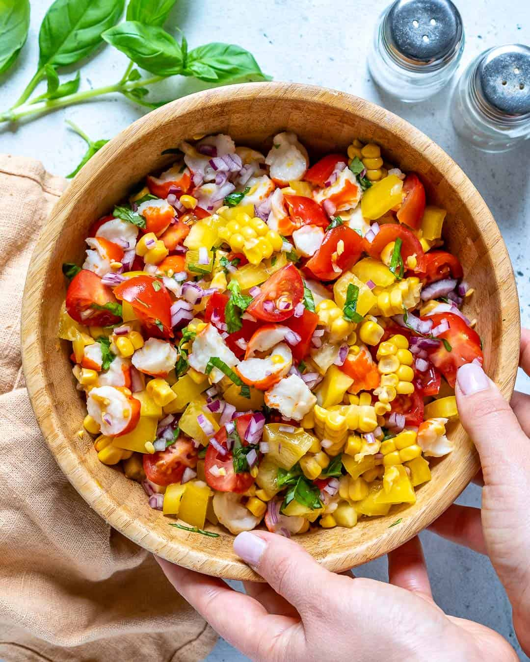 hand holding corn salad bowl
