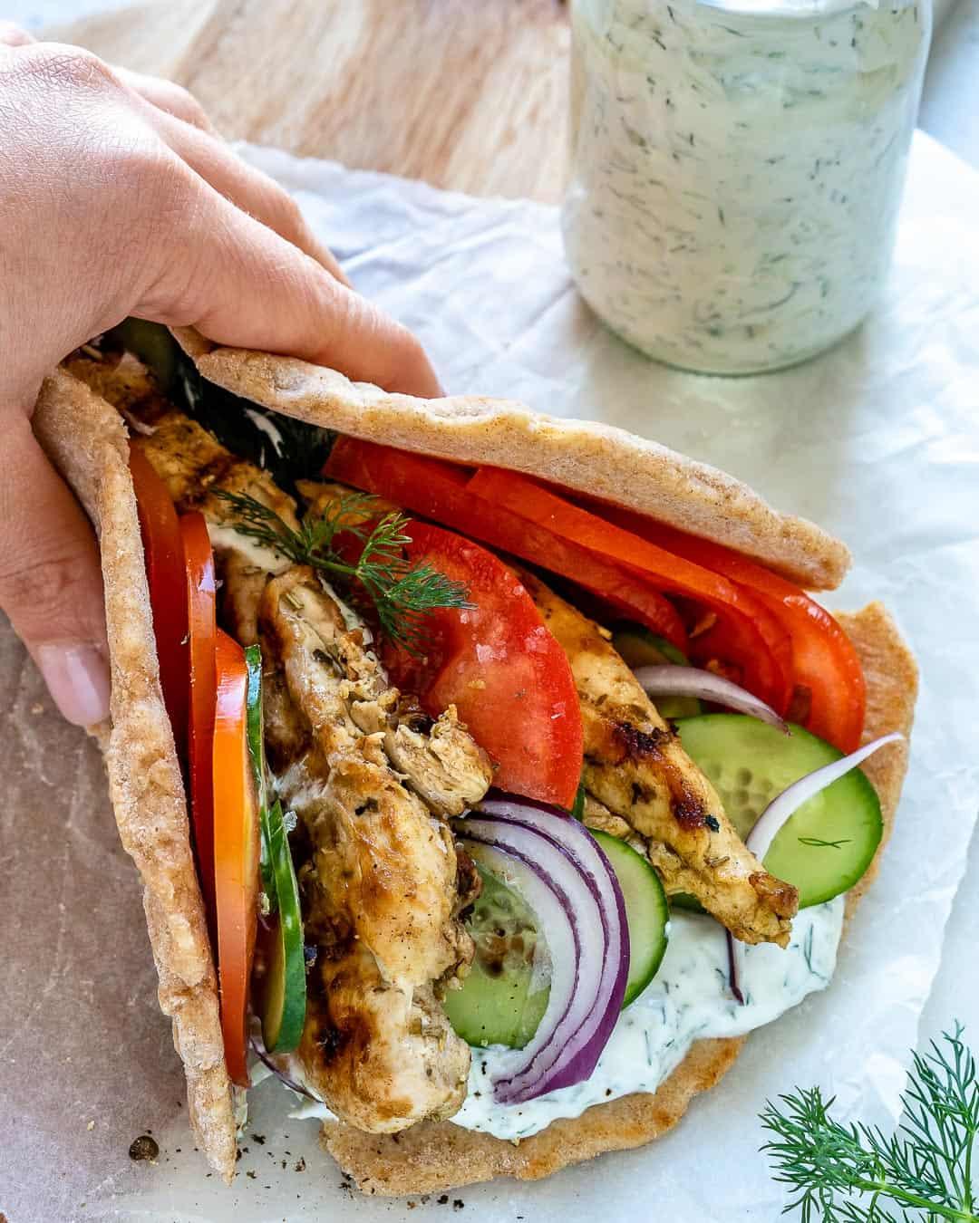 hand holding Grilled Chicken Gyro Sandwich