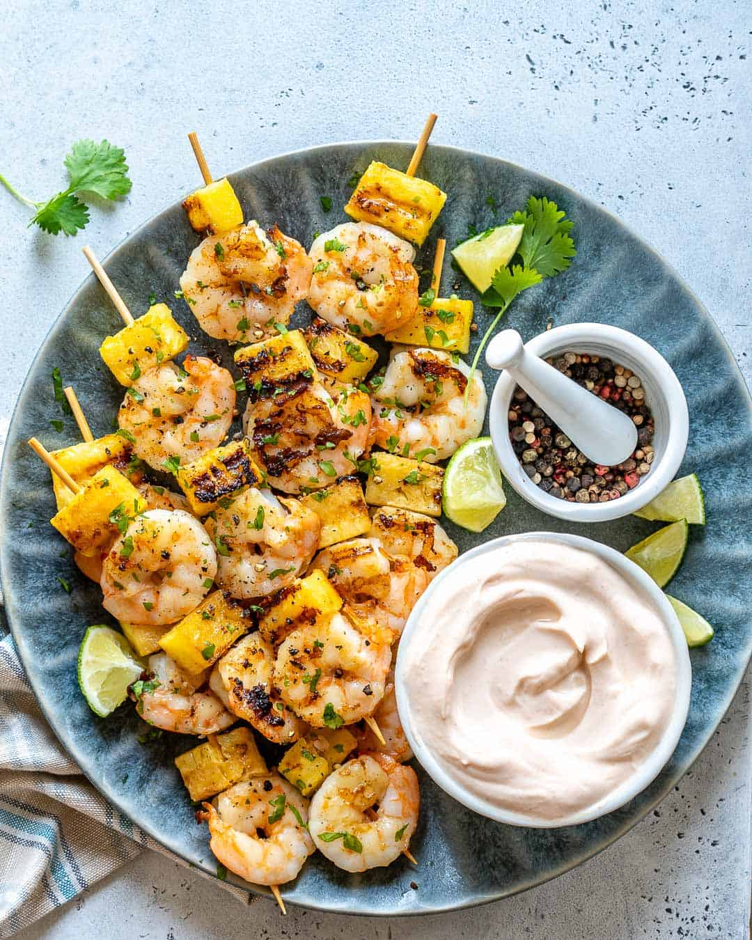 grille shrimp on blue plate with coconut yogurt dip