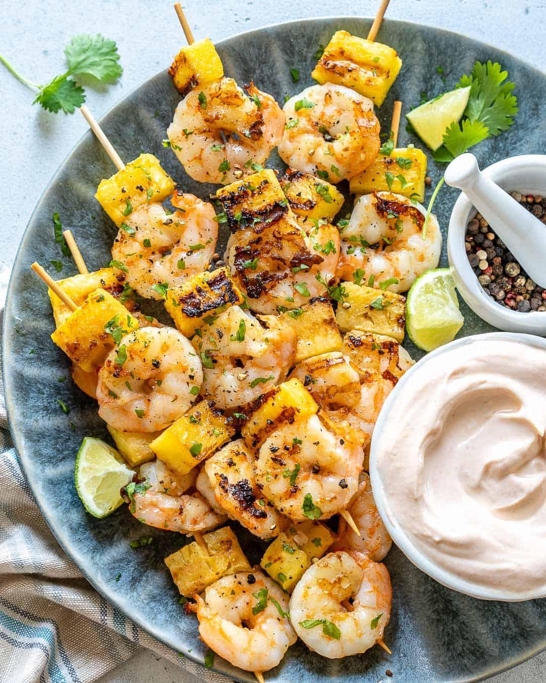 shrimp skewers on blue plate