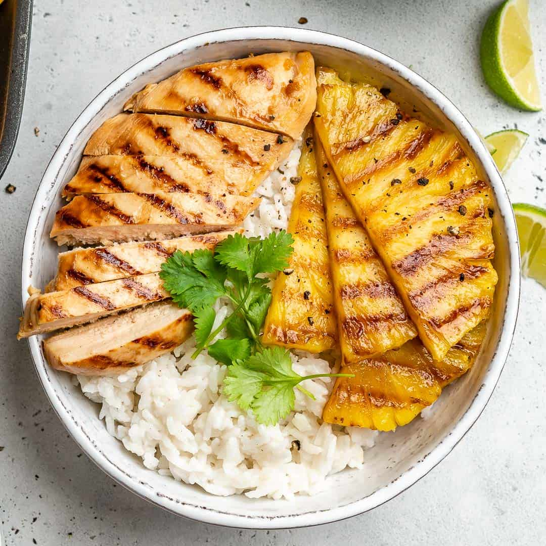 top view grilled chicken and pineapple served over rice