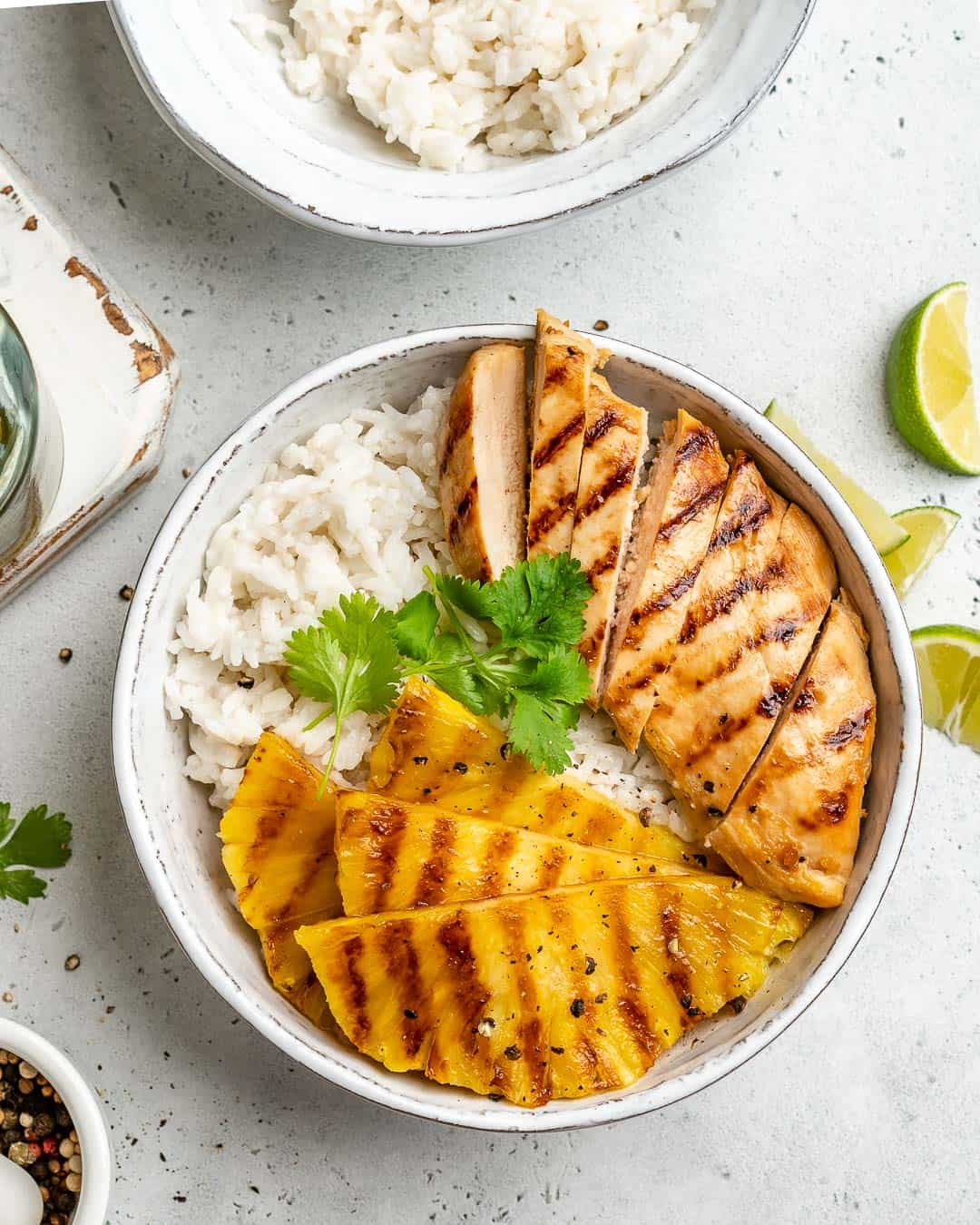 top view of chicken and pineapple over a rice bowl