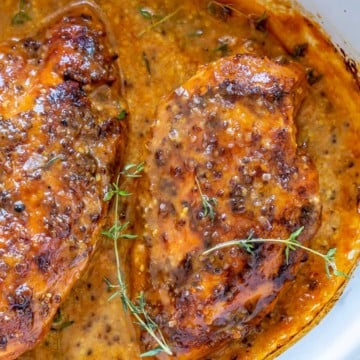 baked honey chicken breast on a white baking dish