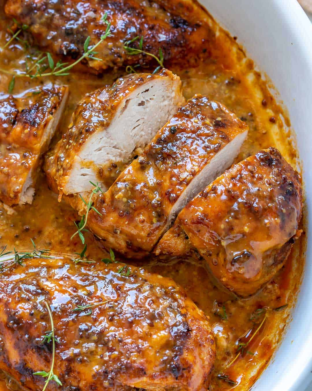 baked chicken in white dish