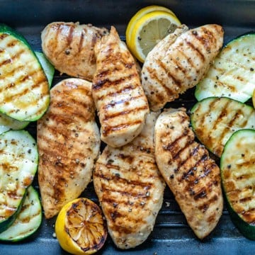 grilled chicken and zucchini on a grill pan