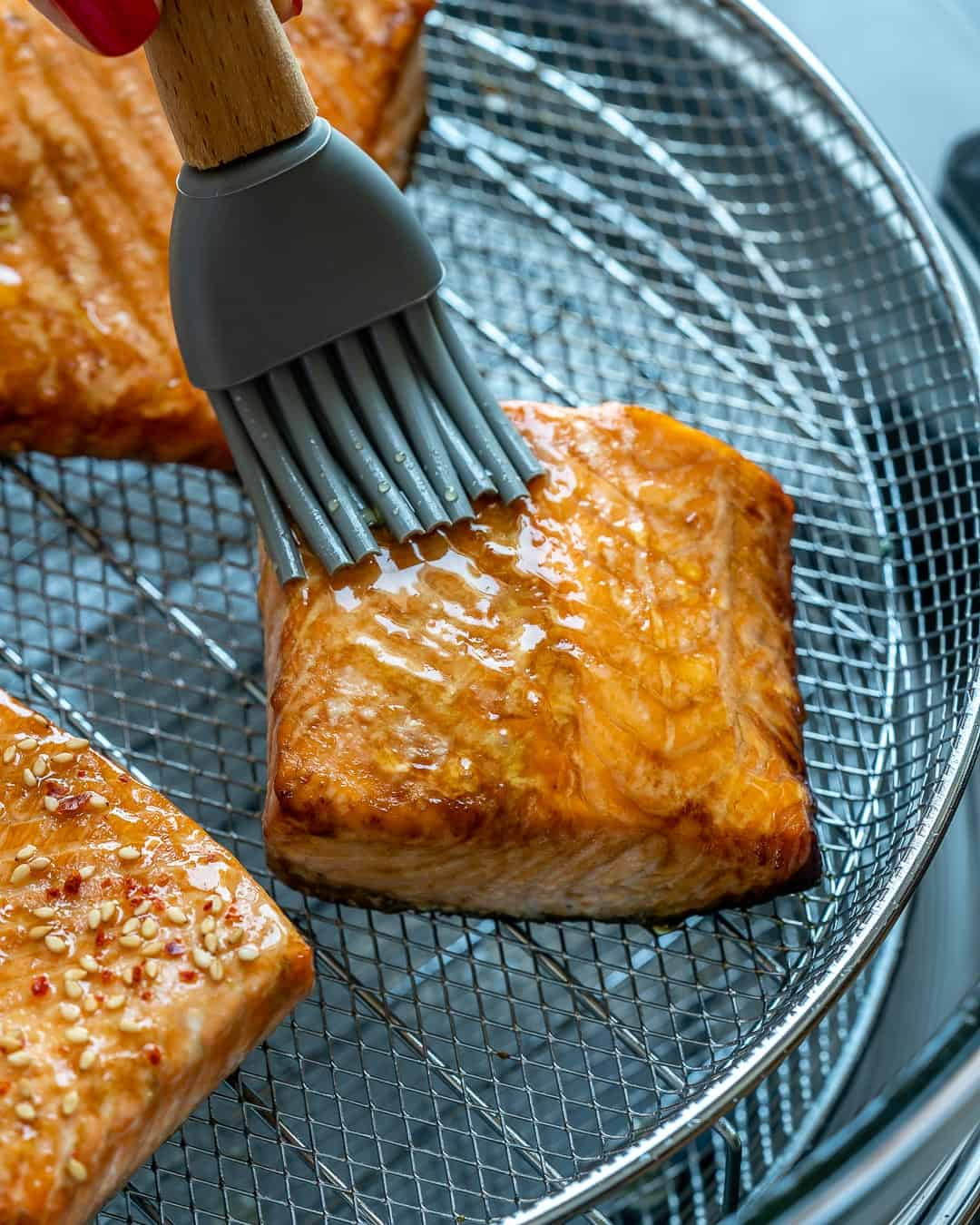 Brush salmon with honey.