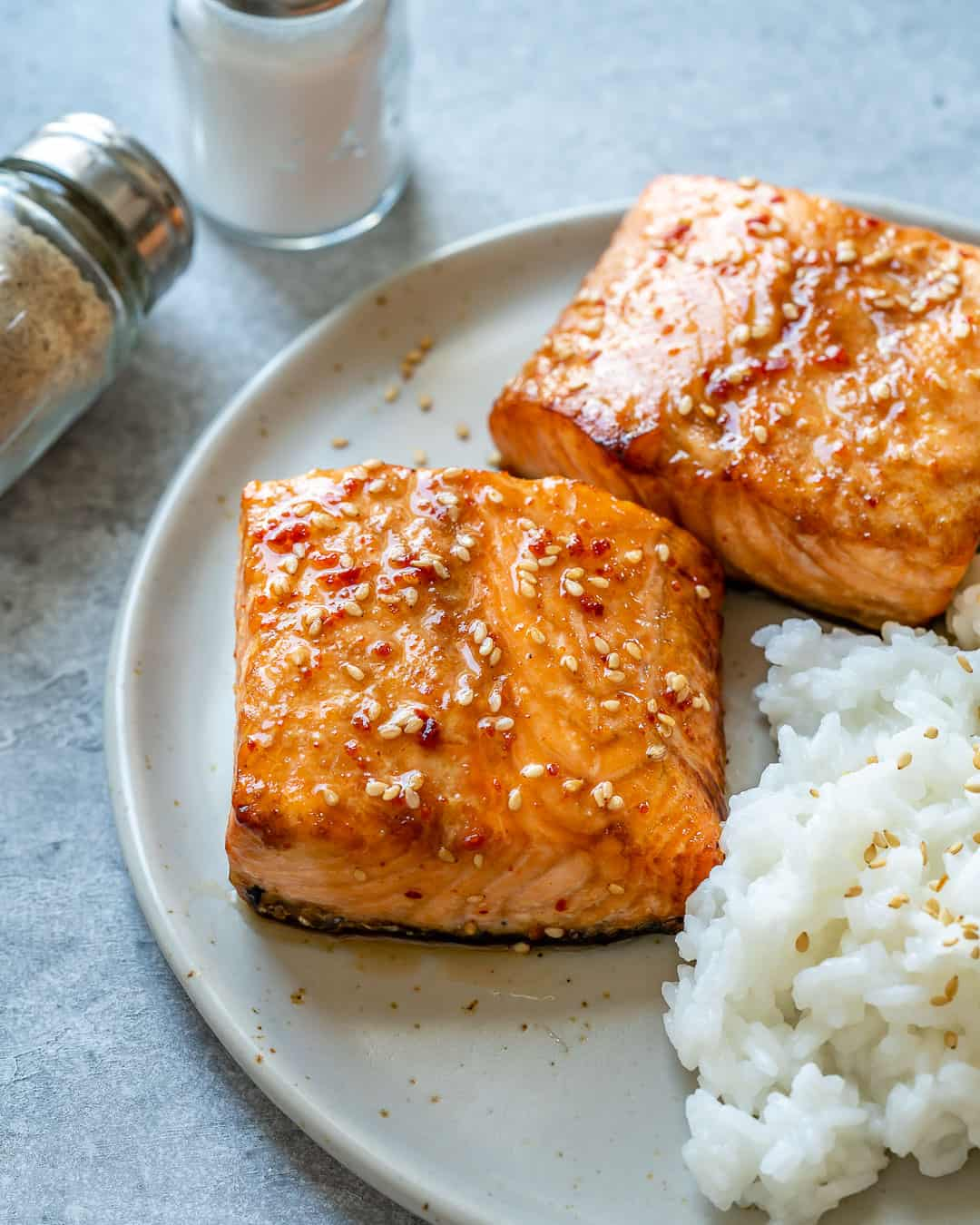 Close up of honey glazed salmon with white rice on plate