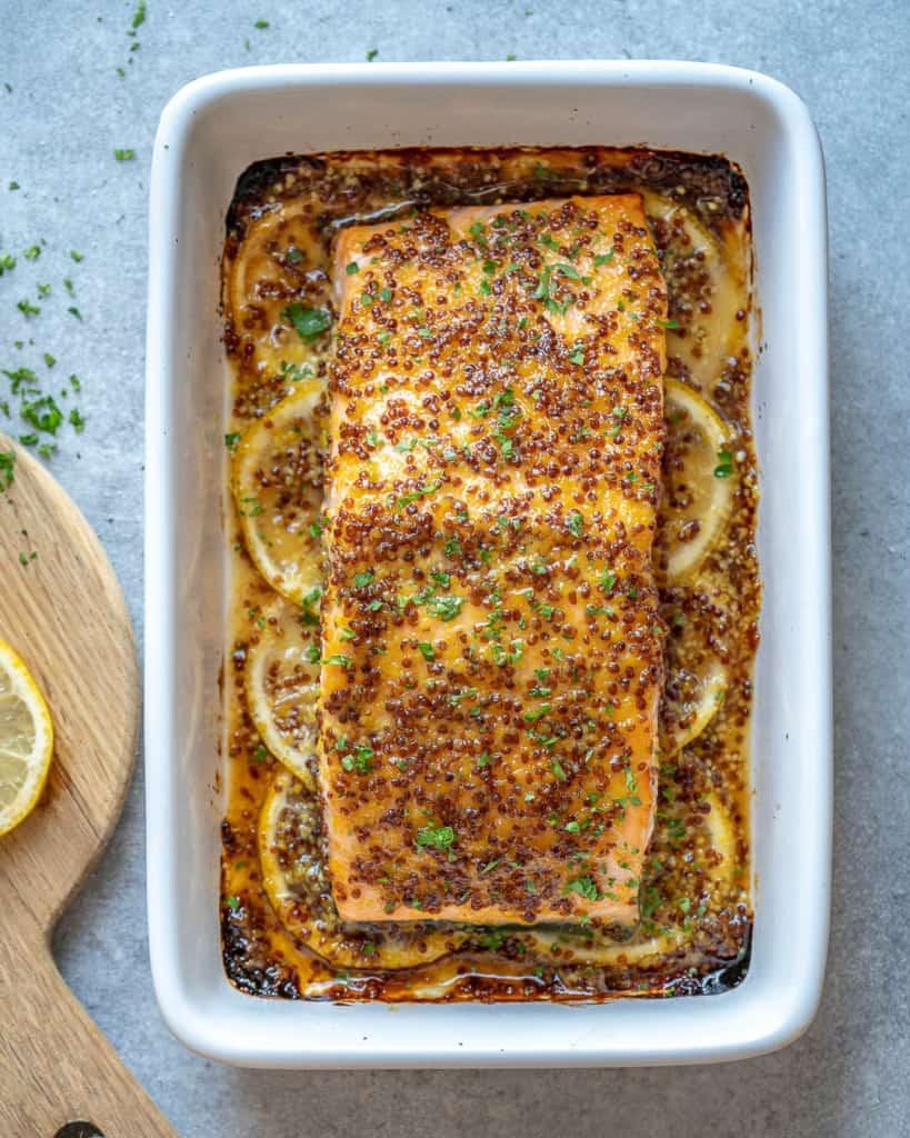 full salmon filet in a baking dish