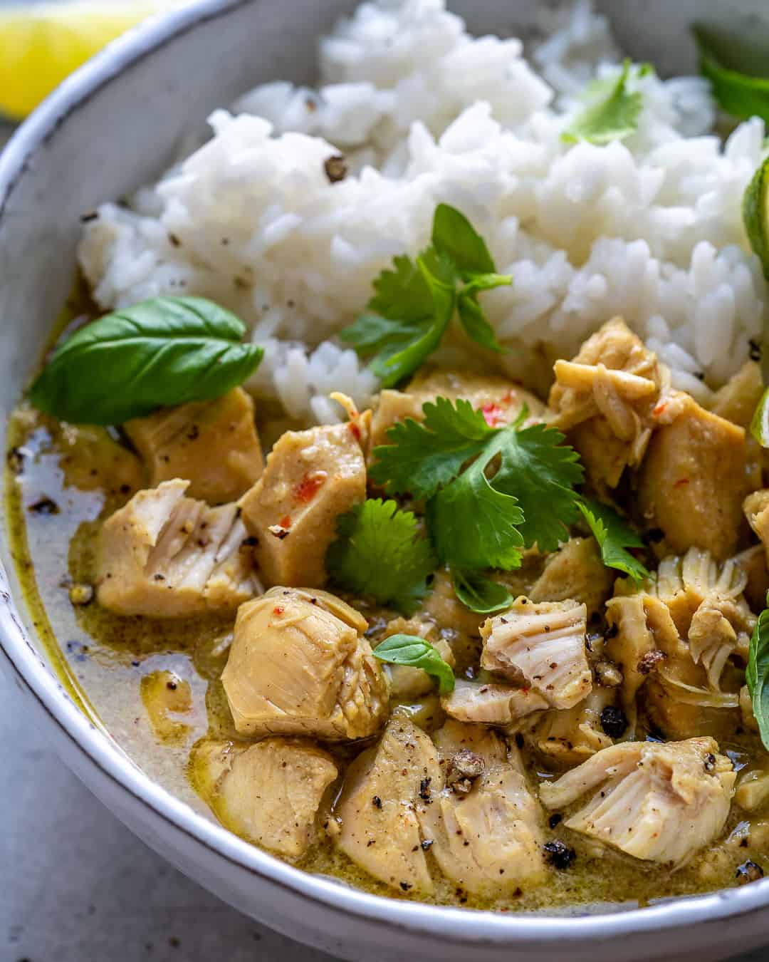 Close up bowl of instant pot chicken curry with white rice