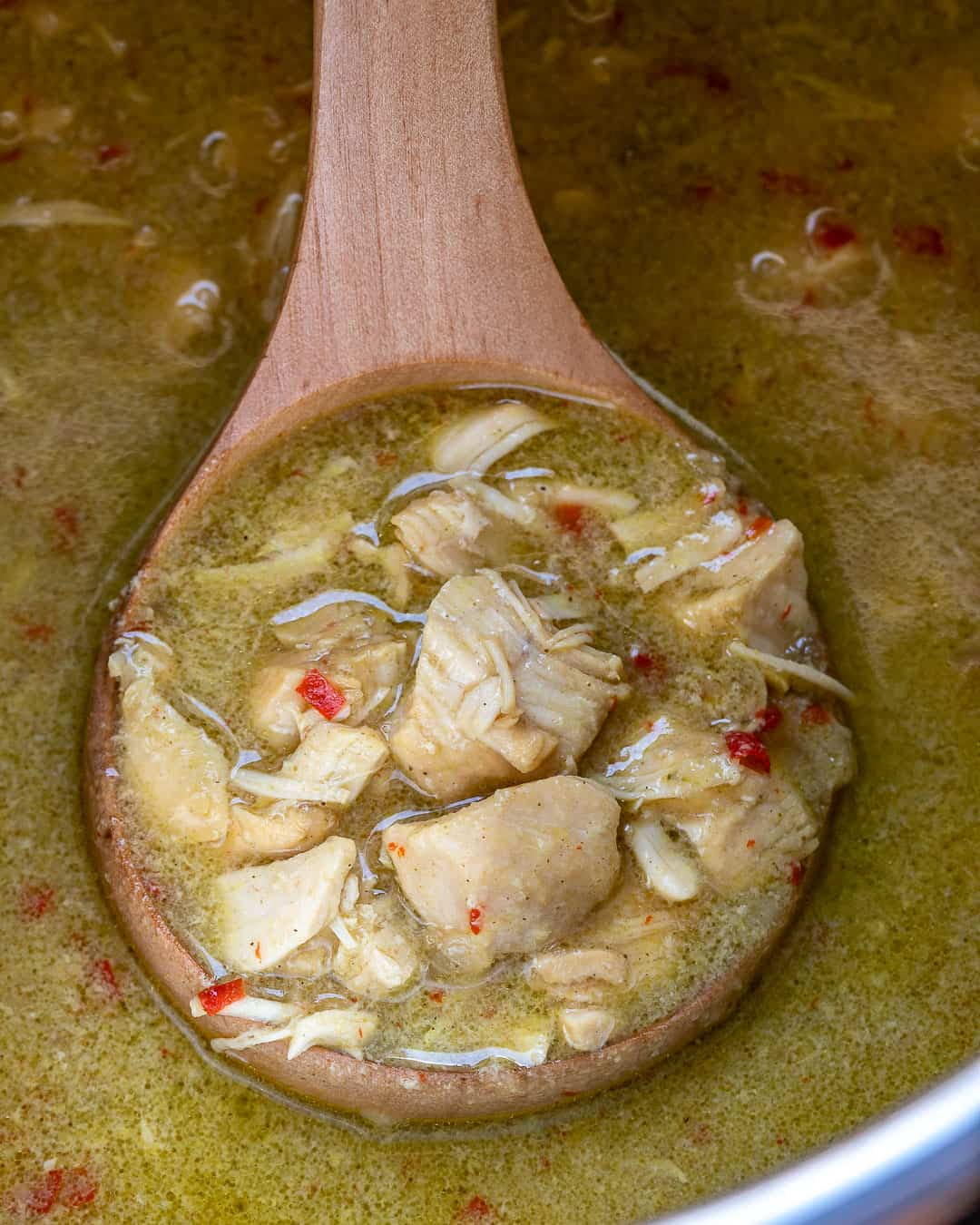 Spoonful of instant pot chicken curry in pot