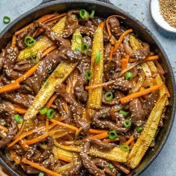 beef stir fry in a black skillet