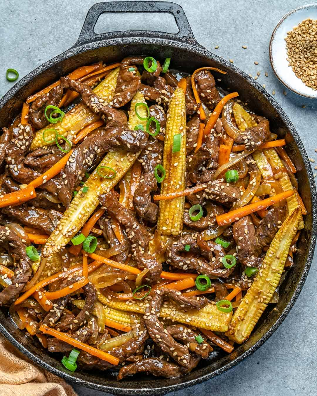 beef stir fry in a black skillet