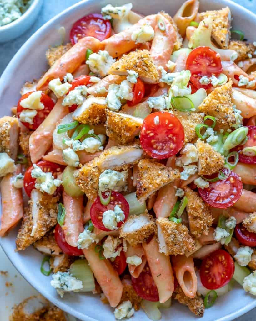 top view of chicken pasta salad with fresh tomatoes and blue cheese